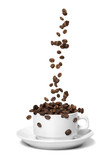 Fototapety Coffee beans falling in white coffee cup. Highspeed shot