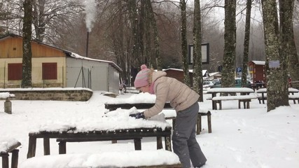 Girl playing on the snow