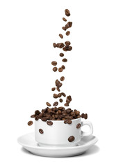 Coffee beans falling in white coffee cup. Highspeed shot