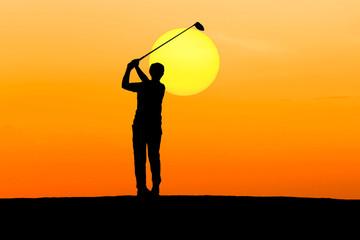 silhouette golfer hitting golf on sunrise