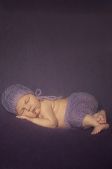 Portrait of Newborn Baby Sleeping in Subtile Hat