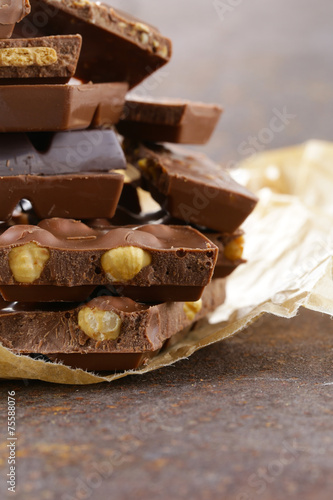 stack of bars pieces of chocolate with different flavors - 75588076
