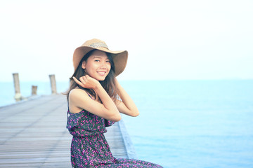 portrait of beautiful woman wearing long dress and straw hat