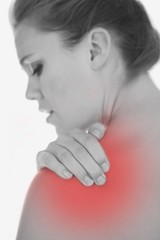 Upset woman suffering from shoulder pain