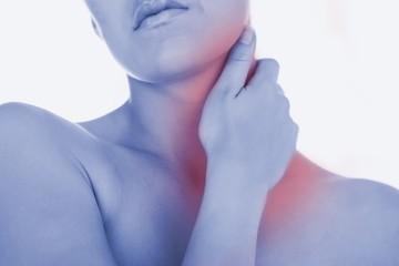Woman massaging neck