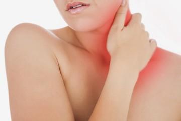 Topless woman massaging neck