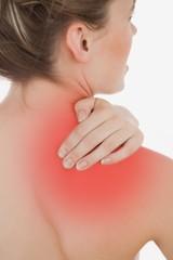 Young woman massaging back