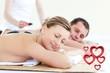 Zdjęcia na płótnie, fototapety, obrazy : Composite image of young couple having a massage with hot stone