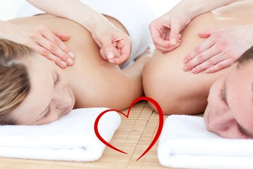 Composite image of relaxed couple in an acupuncture therapy