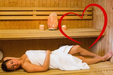 Composite image of happy brunette woman lying in a sauna