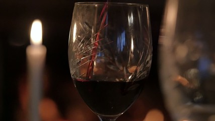 Red Wine glass in front of fireplace