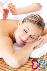 Composite image of attractive woman receiving a tapping massage