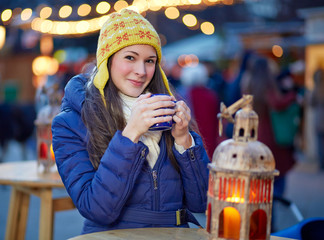Young woman drinking mulled wine on Christmas Market