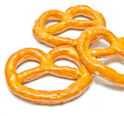 three salted pretzels closeup on white