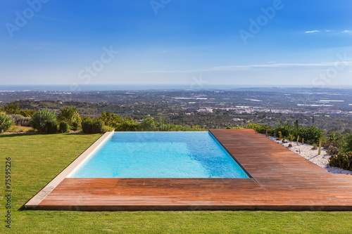 Luxury pool on a background of beautiful scenery. Sea View. - 75595226