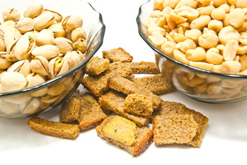 two plates with nuts and crackers