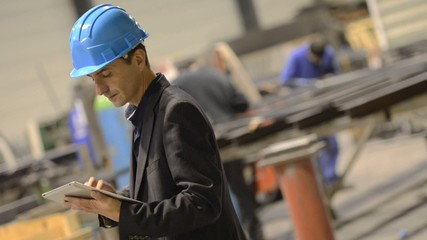 Entrepreneur in manufacture using tablet