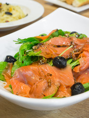 Smoked salmon rocket salad on the white  bowl