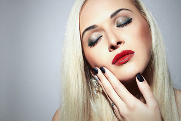 Beautiful blond Woman.beauty make-up.Sexy Girl.Shellac manicure