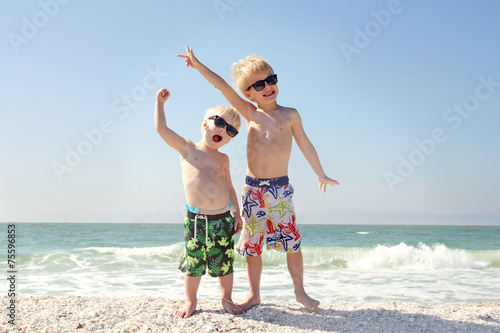 Two Happy Children on Beach Vacation - 75596853