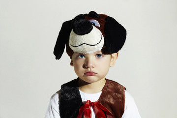 sad little Boy in Carnival Dog Costume.Masquerade.Child