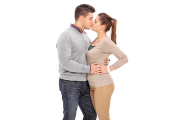 Young couple kissing on white background