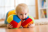 Fototapety baby boy playing with toy indoor