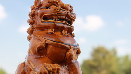 Footage of Chinese lion statue with blue sky