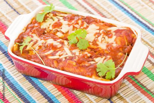 Enchiladas - Mexican tortilla with chorizo and chicken.