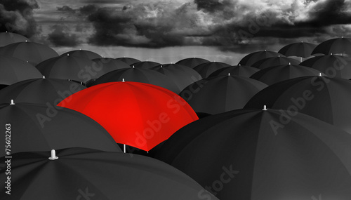 Individuality and different concept of a red umbrella in a crowd - 75602263