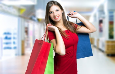 Elegant woman holding shopping bags in a mall