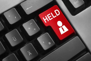 Graue Tastatur mit roter Taste Held Angestellter