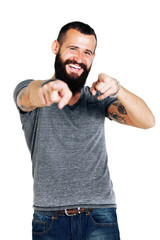 Portrait of smiling handsome Tattooed bearded man pointing at yo