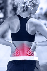 Back pain - Athletic running woman with injury