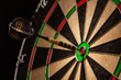 Dart in bull's eye close up - 75605074