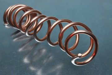 Spiral of copper wire on metal surface abstract industry