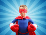 Superhero child with boxing gloves