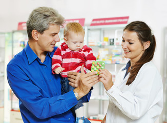 Pharmacy chemist, father and baby in drugstore