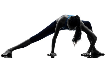 woman exercising yoga stretching legs warm up silhouette