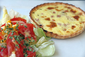 Quiche lorraine with salad on plate France