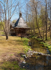 Wooden chapel on the holy spring in the forest