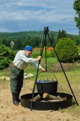 senior preparing camping fire