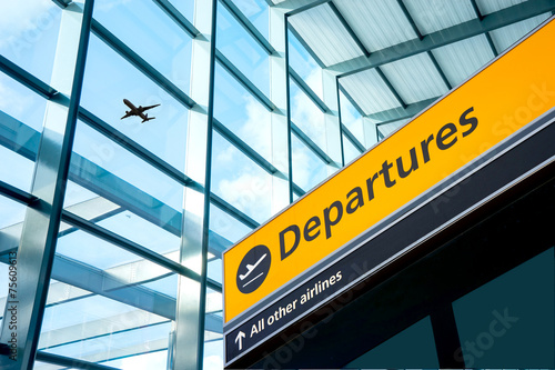 Airport Departure and Arrival sign at Heathrow, London - 75609613