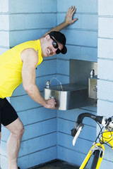 man at a drinking fountain