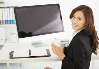 happy young businesswoman working in the office