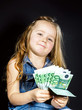 Cute little girl with money euro in her hand.