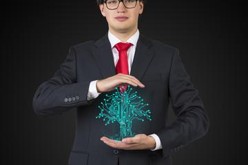 businessman holding electronics tree
