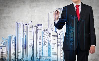 businessman drawing city