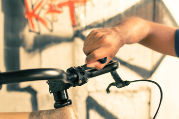 Man repairing a bicycle handle