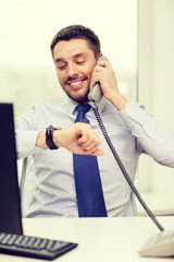 smiling businessman making call